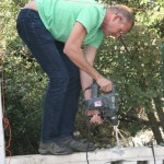 Steve drilling thru the wall at Fi & Dave's to make an opening to their new 'garden'